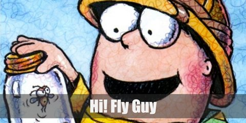 Fly Guy costume is a brown sweater, black jeans, white thick cardstock paper, garter, and a black sharpie.