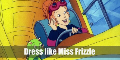 Miss Frizzle's costume consists of a very unique blue dress covered in items you would find in space, a green lizard toy as your pet, some bright red heels, and a statement-making orange wig.