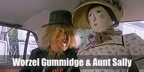 Worzel Gummidge costume is a dirty suit and lots of hay to show that he is, indeed, a scarecrow. Aunt Sally wears a simple colonial dress, a farmer's hat, and formidable boots.
