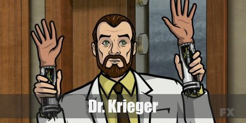 Dr. Krieger wears a long white lab coat. Under this lab gown is a yellow button-down shirt with a brown necktie. He wears light brown pants with a belt. He has black shoes, too. To complete the look, wear a brown wig with beard.
