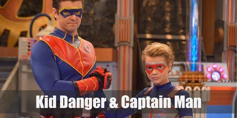 Kid Danger costume is a blue zip up jacket with a silver vest over it, red pants, black boots, and a red eye mask.