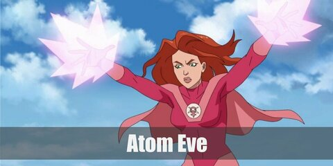 Atom Eve's costume consists of an all-pink ensemble featuring a long sleeved pink top as well as pink shorts. Add a pair of gloves and boots plus a pink cape to complete to look.
