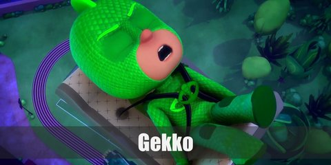 Gekko of PJ Masks' costume includes an all-green body suit and a reptile scales on the head as headband. He also has green elbow pads to recreate his shields as well as matching knee pads. To complete his look, wear a green tail and green shoes.