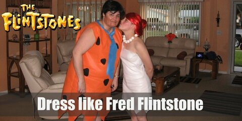 Fred Flintstone's daily attire is nothing more than some sort of orange nightgown  riddled with curvy, black triangles and a blue tie. More elaborated versions include detached cuffs and lapels to give it a more formal air.