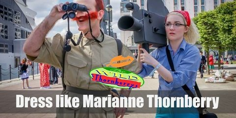 To dress like Marianne Thorberry you'll need dyllow vest, blue jeans, olive green, lace-up boots, a red bandanna and oval reading glasses.