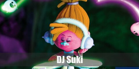 DJ Suki's costume features a full-body later of pink paint. Then wear a cropped top and white shorts. Complete the costume with an orange wig and colorful bangles and head phones,too
