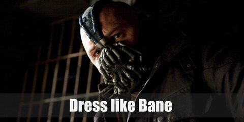 Bane's wears a durable vest, cargo pants, combat boots, and a thick brown jacket.