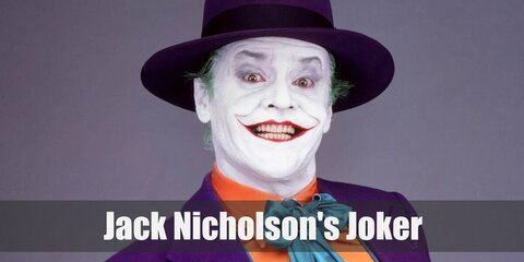 Jack Nicholson's The Joker's costume is an orange dress shirt, a green vest, a purple blazer, purple pants, a green bow tie, and a purple hat. He also has clown-white skin, green hair, and very red lips.