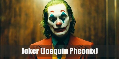 Joaquin Phoenix Joker's costume is a green collared shirt, a yellow vest, a green wig, clown makeup, and a red suit. Joker goes away from the classic purple and green of the character and creates something new.