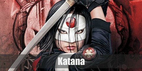 Katana's costume is a white cropped top a black cropped jacket, black pants, black-thigh high boots, black fingerless gloves, a red sash, and a white mask.
