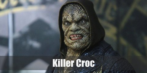 Killer Croc's villainous costume is a brown hoodie, a black leather jacket, black pants, and black boots.