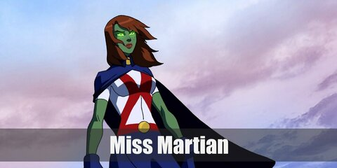 For Miss Martian costume, wear a green body suit and green face paint to nail her skin. And then get a white shirt with red markings and navy skirt. Top it off with boots, gloves, and an orange wig, too!