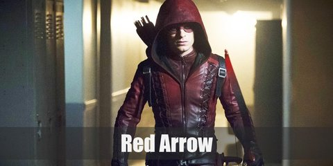 Red Arrow costume is a red hooded leather jacket, black leather pants, black boots, black gloves, and a red leather eye mask