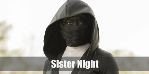 Sister Night costume is a black mask, beads dangling from the waist, as well as a pair of boots to complete costume.