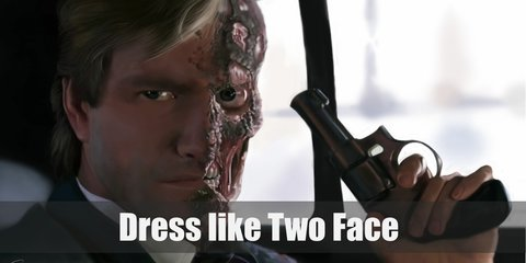 The hardest part of looking like Harvey Dent is getting the scarring of his face right through FX makeup and liquid latex. For costume, you need a gray business suit, black Oxfords, and a red tie.
