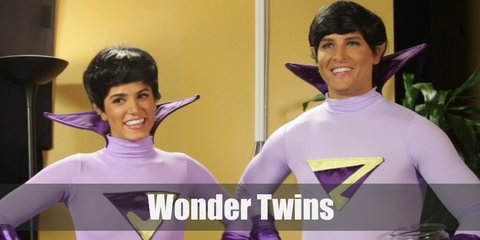 Jayna and Zan's costume from Wonder Twins primarily consists of purple body tights with a belt, a pair of gloves, boots, and a high collar. They also sport matching short black hair.