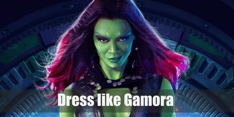 Gamora's outfit looks like a mix between explorer and goth. She loves her leather. She wears a black bustier, black pants, black boots, and a dark long coat which stands out against her green skin.