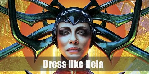 Hela costume is looking like an avenging angel in her black and green turtleneck, off-shoulder jumpsuit. She also wears a really cool looking headpiece.
