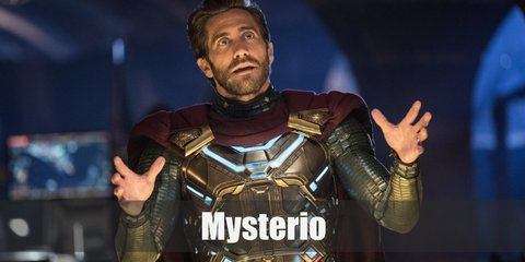 Mysterio's costume in the latest Spider-Man film is a green and gold outfit with a red cape, and a fishbowl-like helmet.