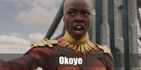Okoye cosutme is bright orange uniform. You will need a long-sleeved orange shirt, black pants, armor, and a spear.