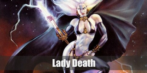 Lady Death's costume is composed of leather bra and bikini bottom paired with garters and thigh high boots. Complete her look with fingerless gloves, gold accessories, as well as a white wig.