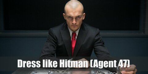 Agent 47 simply wears a clean black suit with white shirt and red necktie, finger-less gloves, formal leather shoes.