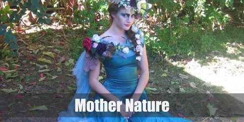 Mother Nature costume is mostly wearing green and brown tones, with flora and fauna skirting around her outfit.