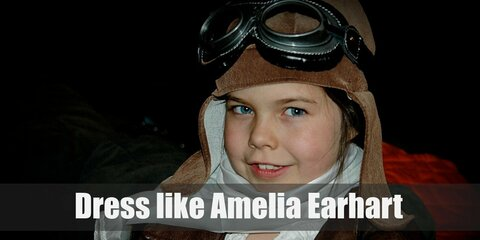 All you need for your Amelia Earhart costume is some aviator gear such a goggles, a bomber jacket, tall leather boots, and khaki pants.