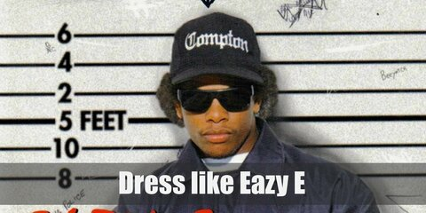 Eazy-E defined what an MC looks like with fashion from the hood. Black baseball cap with matching sunglasses, jacket and fingerless gloves. Throw in an oversized t-shirt, relaxed pants for comfort and some sneakers for style.