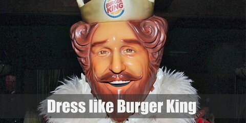 The Burger King looks like a red-haired, Tudor-ere monarch with his yellow undergarments, regal cape, white tights, and black boots. He also wears a crown atop his head.