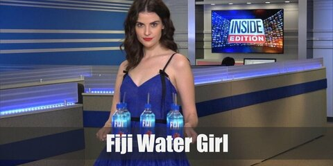 Fiji water girl costume is wearing a blue dress and a pair of pumps or heels. Then carry a clear tray with Fiji water bottles, too.