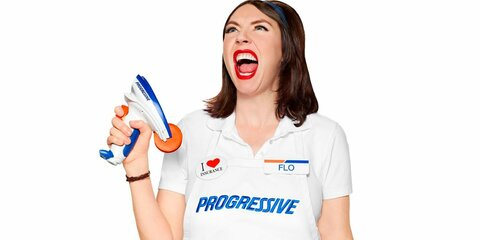 Flo's look is very simple with the clean, all-white uniform of Progressive with a white Progressive Apron on top. Her poofy hairstyle and red lipstick gives her a very retro look.
