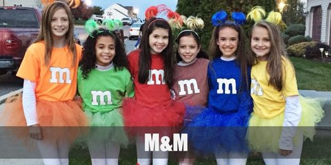 "M&M's costume can include color-coordinated tops and skirts with a large ""m"" at the front. The whole squad can get a color and go matching in this costume."