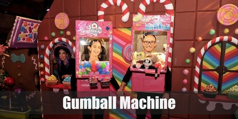 The Bubble Gum Machine costume includes a white shirt with multicolored pompoms all over the midriff. It is paired with a red skirt and a matching red beret. Decorate the skirt with silver foil designed with a slot machine shape in form of sticker and marker.