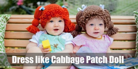 A Cabbage Patch Kid doll comes in many different skin colors, hair colors, and accessories. But they all have similarities in that they have the same round face, body shape, and the same hair made from yarn.