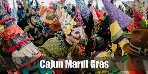 The Cajun Mardi Gras costume can be recreated by sticking strips of ribbon or crepe paper on the clothes and masks. Top it off with a cone hat and a mask!