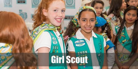 Girl scout costumes consist of a white top and green skirt. THey also have a green sash adorned with various pins. Complete the look with a neckerchief, beret hat, long socks, and shoes.