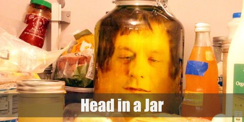 The Head in a Jar costume is an easy illusion to pull off with the right tools. Aside from the trench coat and the jar, you will need a backpack, stuffing, and a whole lot of creativity.