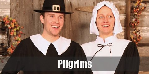 The female pilgrim's costume inludes a black and white dress. She has a bonnet and wears a black pair of shoes. The male pilgrim wears a black long sleeved-top with loose pants. He has a pilgrim hat with a belt and black shoes.
