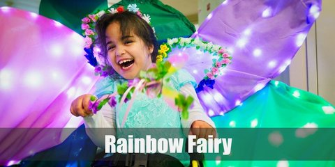Rainbow Fairy costume can be nailed with a colorful corset and matching skirt. She can also wear a rainbow pair of socks and colored pumps. To complete the look, wear a colored wig and cute fairy wings.