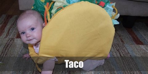 Baby or Child Taco's costume includes a taco shell foam body with green, blue, white, red, and yellow pieces of cloth. Wear a taco hat to complete the look.