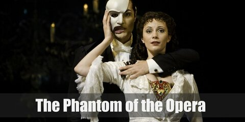 The Phantom wears a dapper costume consisting of a white dress shirt, black vest, black coat, black dress pants, black Oxfords, white gloves, black cape, and a personalized white half-mask.