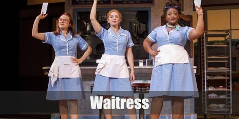 A waitress wears a classic blue waitress uniform with a name tag on it, a white apron with a napkin, white socks, and white sport shoes.