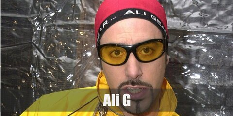Ali G costume is a matching yellow jacket and pants. He also wears a red beanie with accessories include a watch, necklace, and rings that are all crystal-embellished.