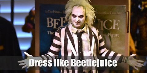 Beetlejuice costume is an iconic black and white-striped suit that makes him look like half a salesman and half a prisoner. He has wild, messy, thin, green hair and his complexion is white.