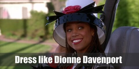 Dionne Davenport costume is a white shirt topped with a red sweater and crop black plaid jacket, a tall hat, a plaid skirt, long black socks and black shoes.