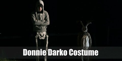 Donnie Darko dresses up in a simple costume of a skeleton full body suit with a gray hoodie over the top. This costume is very simple and fits his moody-don't care-troubled teenager attitude.