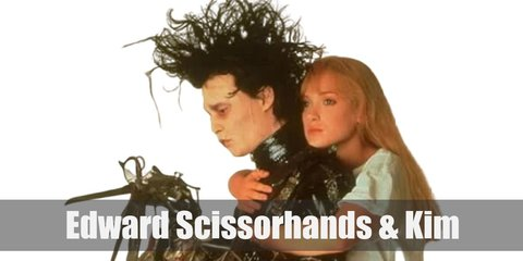 Edward Scissorhand's costume is a white dress shirt with a black ascot, black pants held up with black suspenders, and his iconic blade-like hands. Kim's costume is an off-shoulder white dress and white heels.