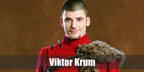 Viktor Krum's costume is a red long-sleeved formal top, brown pants, black knee-high boots, a black belts, and a fur-lined red shoulder cape.