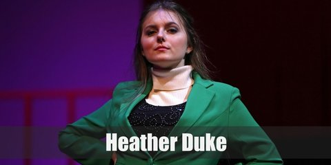 Heather Duke's costume is a green blazer, a black pleated skirt, green knee-high socks, and black Mary Janes.